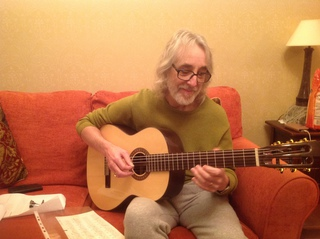 Taken a few weeks ago after the operation of me playing a lovely Santos Martinez guitar bought for a friend