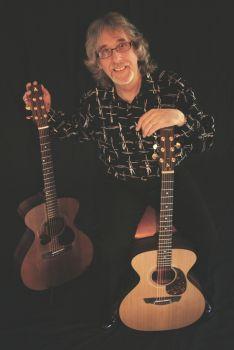 Gordon with original and new signature guitar